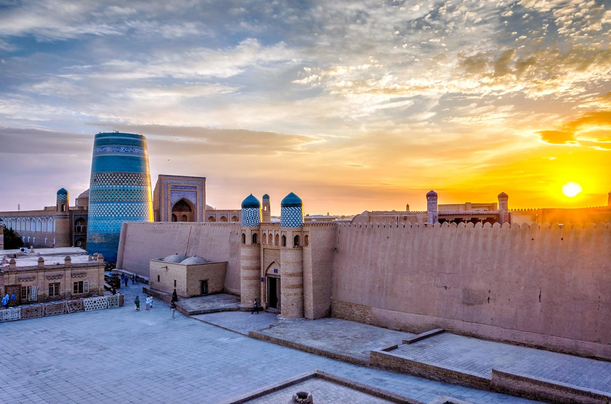 Old city wall and minaret at sunset, Khiva old town, Uzbekistan