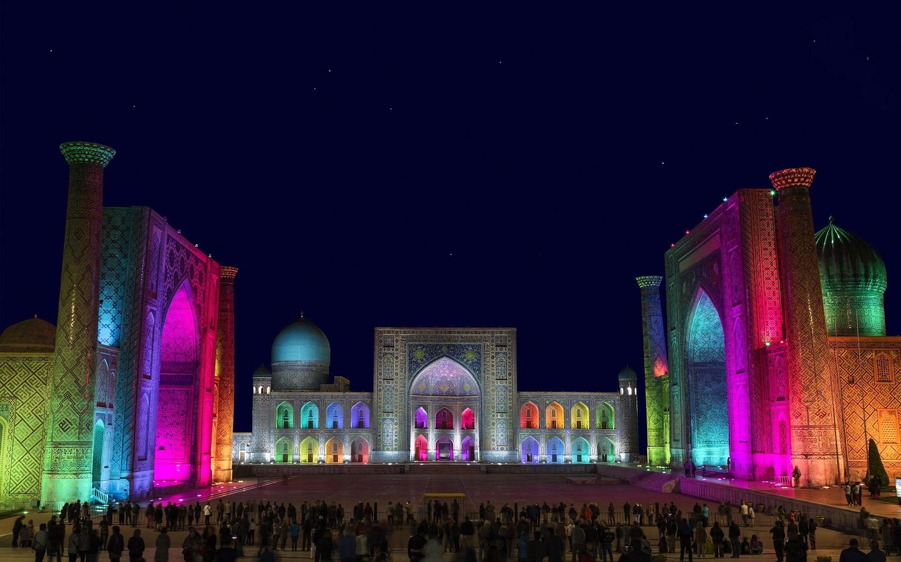 View of Registan square in Samarkand with Ulugbek madrassas, Sherdor madrassas and Tillya-Kari madrassas at night during the color show. Uzbekistan