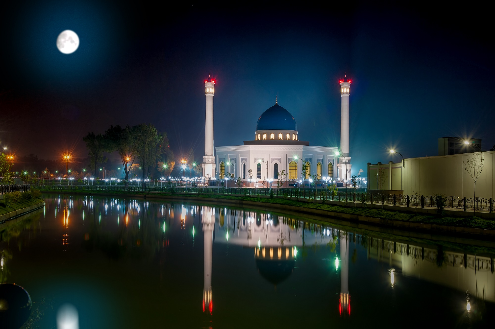 Beautiful Night Shot of Big New Mosque Minor, With Reflection in Water Under a Full Moon. Uzbekistan, Tashkent.
